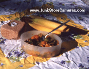 Casserole in Tupperware with banana and brick candle holder.
