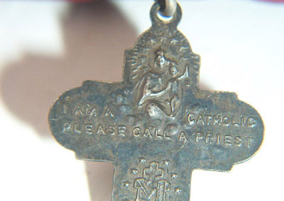 This Catholic medal was attached to the case.
